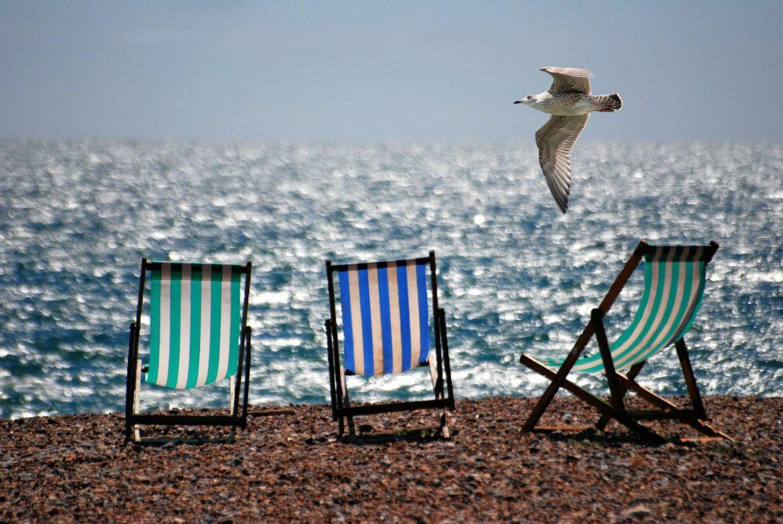 beach-deckchairs-ocean-54104